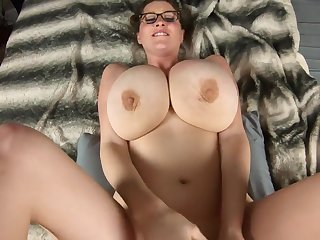 Nurturer in glasses shows off her huge breasts