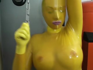 Cooky Full Encased In Yellow Latex Catsuit + Fishnets Makes Self Bondage